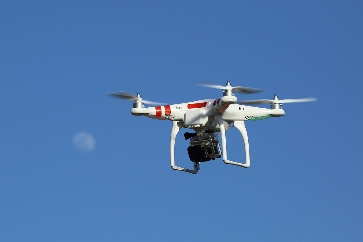 """Drone with GoPro digital camera mounted underneath - 22 April 2013"" by Don McCullough from Santa Rosa, CA, USA - Drone and Moon. Licensed under CC BY 2.0 via Wikimedia Commons - http://commons.wikimedia.org/wiki/File:Drone_with_GoPro_digital_camera_mounted_underneath_-_22_April_2013.jpg#mediaviewer/File:Drone_with_GoPro_digital_camera_mounted_underneath_-_22_April_2013.jpg"