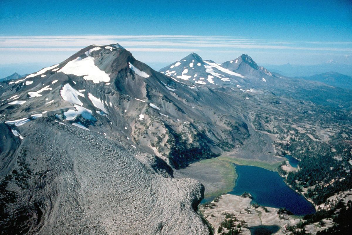 """Three sisters2"" by USGS Photograph by Lyn Topinka. - http://vulcan.wr.usgs.gov/Volcanoes/Sisters/Images/framework.html. Licensed under Public Domain via Wikimedia Commons - https://commons.wikimedia.org/wiki/File:Three_sisters2.jpg#/media/File:Three_sisters2.jpg"