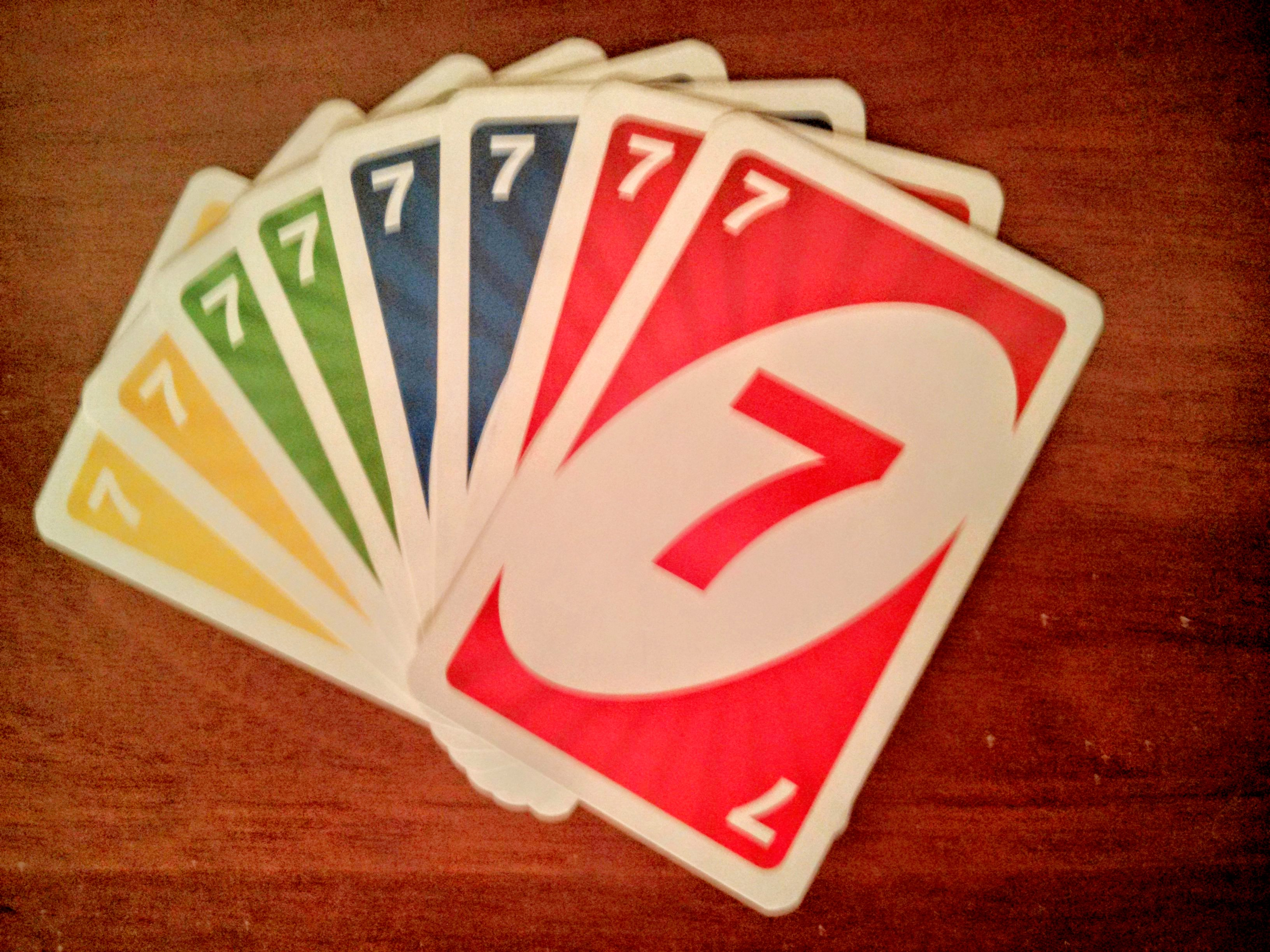 multiple Uno cards, all of them are sevens.