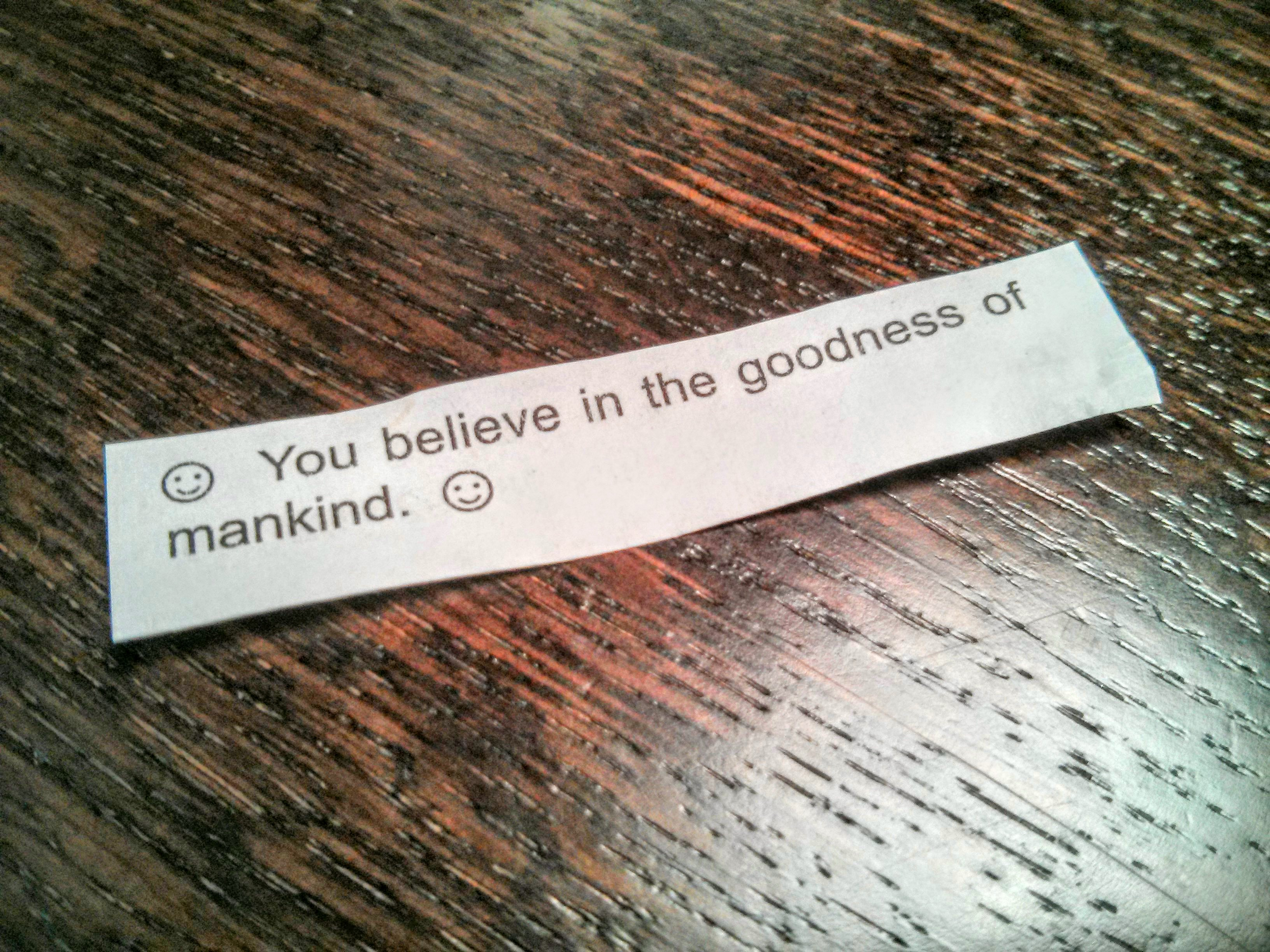 "Fortune cookie message that reads ""You believe in the goodness of mankind."""
