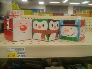 three tissue boxes, with Christmas themes of Santa, a snowman, and penguins.